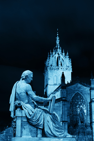 giles: St Giles Cathedral with David Hume statue as the famous landmark of Edinburgh. United Kingdom.