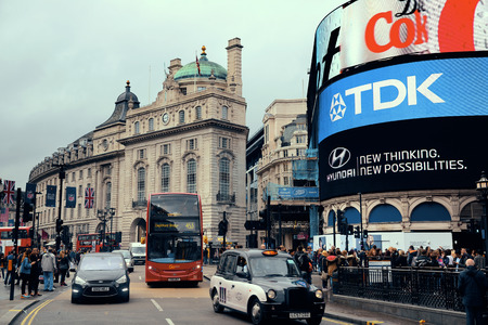 piccadilly: LONDON, UK - SEP 27: Piccadilly Circus street view on September 27, 2013 in London, UK. Built in 1819, it is the major shopping, entertainment areas and key tourist attractions in London. Editorial