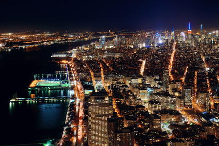 hudson river: Rooftop night view of New York City midtown and Hudson River with urban skyscrapers