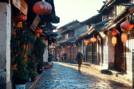 history building: Lijiang, CHINA - DEC 5: Street view on December 5, 2014 in Lijiang, China. Lijiang old town is a UNESCO Heritage Site with 800 years history and confluence for trade along the old tea horse road.