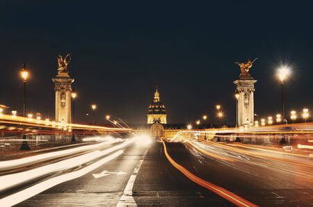 light trail: Alexandre III bridge night view with Napoleons tomb and light trail in Paris, France. Stock Photo