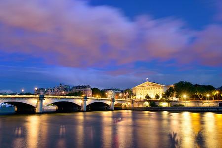 concorde: Paris River Seine with Pont de la Concorde and Assemblee Nationale at dusk Stock Photo