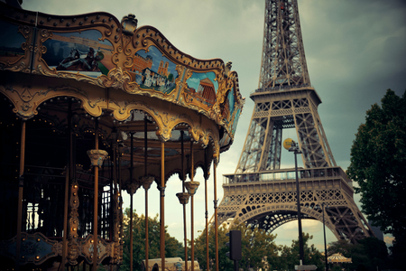 carrousel: PARIS, FRANCE - MAY 13: Carrousel and Eiffel Tower on May 13, 2015 in Paris. With the population of 2M, Paris is the capital and most-populous city of France