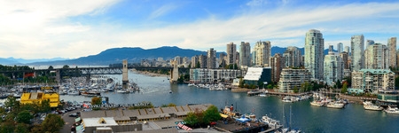 ethnically diverse: VANCOUVER, BC - AUG 17: Vancouver bay aerial view on August 17, 2015 in Vancouver, Canada. With 603k population, it is one of the most ethnically diverse cities in Canada. Stock Photo