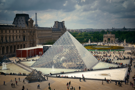 louvre pyramid: PARIS, FRANCE - MAY 13: Louvre pyramid closeup exterior view on May 13, 2015 in Paris. With over 60k sqM of exhibition space, Louvre is the biggest Museum in Paris.