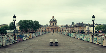 history building: Pont des Arts over River Seine in Paris.