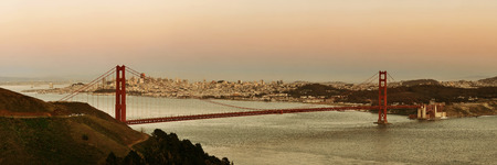 steel tower: Golden Gate Bridge panorama at sunset in San Francisco as the famous landmark.