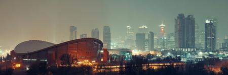 calgary: Calgary cityscape in Alberta at night in a foggy day, Canada. Stock Photo