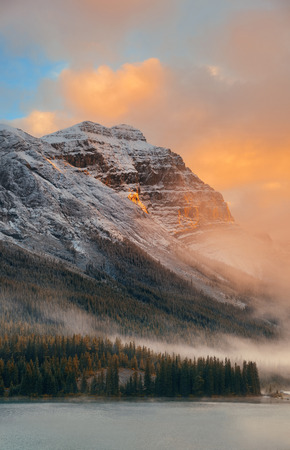 banff: Snow capped mountain and fog at sunset in Yoho National Park in Canada Stock Photo