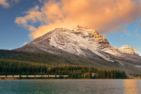 banff national park: Mountain lake with reflection and fog at sunset in Banff National Park, Canada.