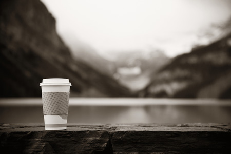 banff national park: Lake Louise with coffee cup in Banff national park with mountains and forest in Canada.