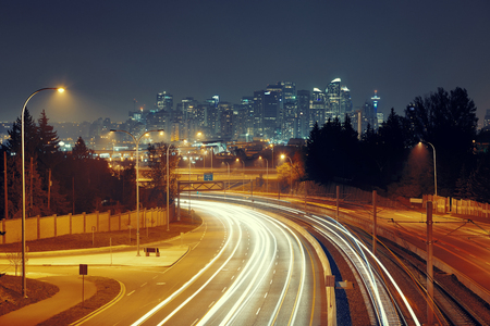 calgary: Calgary downtown with light trails at night, Canada. Stock Photo