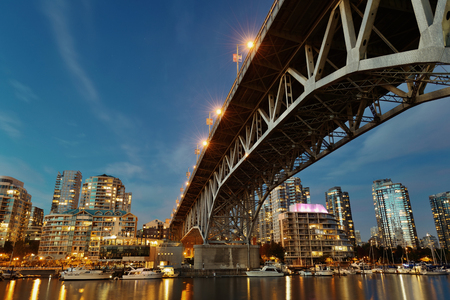 bc: Vancouver False Creek at night with bridge and boat. Stock Photo
