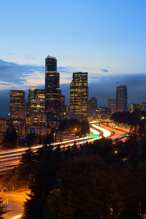 light trail: Seattle city view with urban architecture and traffic light trail at dusk.
