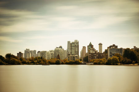 city park skyline: Vancouver city skyline viewed from Stanley Park. Stock Photo