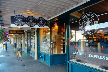 SEATTLE, WA - AUG 14: The first Starbucks Coffee shop on August 14, 2015 in Seattle. Seattle is the largest city in both the State of Washington and the Pacific Northwest region of North America Editorial