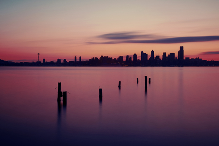 space needle: Seattle sunrise skyline silhouette view with urban office buildings. Stock Photo