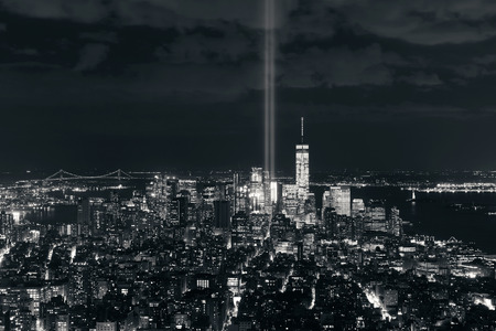 New York City downtown skyline view at night with September 11 tribute light. Banco de Imagens