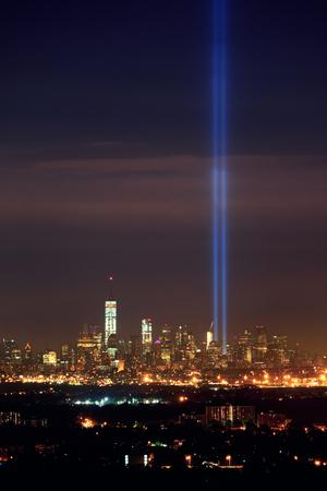 september 11: New York City skyline at night and September 11 tribute light Stock Photo