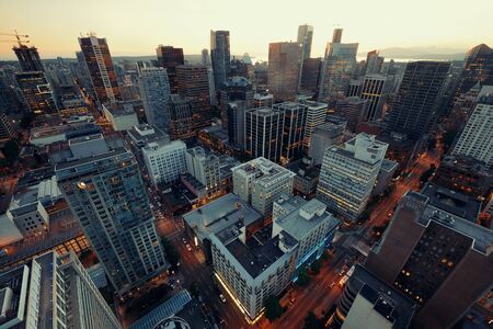 office building: Vancouver rooftop view with urban architectures at sunset.