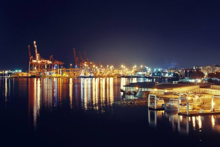ethnically diverse: VANCOUVER, BC - AUG 17: Sea port with crane and cargo containers at night on August 17, 2015 in Vancouver, Canada. With 603k population, it is one of the most ethnically diverse cities in Canada. Editorial