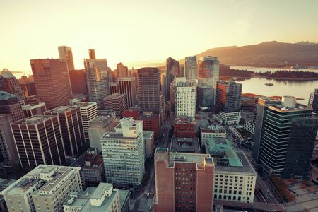 coastal: Vancouver rooftop view with urban architectures at sunset.
