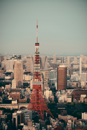 Tokyo Tower and urban skyline rooftop view at sunset, Japan. Stock Photo