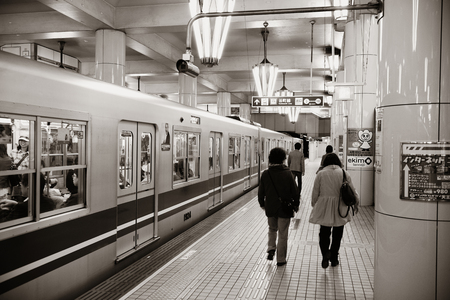 railway transportations: OSAKA, JAPAN - MAY 11: Subway station interior on May 11, 2013 in Osaka. With nearly 19 million inhabitants, Osaka is the second largest metropolitan area in Japan after Tokyo. Editorial