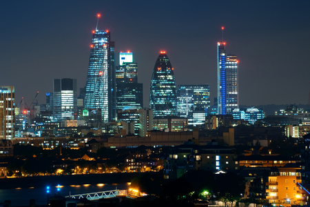 London cityscape with urban buildings over Thames River at night Reklamní fotografie