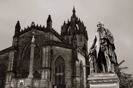 walter scott: St Giles Cathedral with Duke of Buccleuch (Walter Scott) statue as the famous landmark of Edinburgh. United Kingdom.