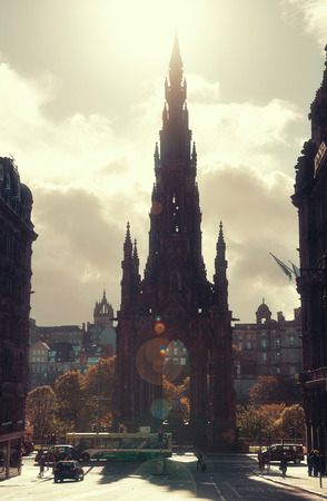 walter scott: EDINBURGH, UK - OCT 8: Scott Monument with street view on October 8, 2013 in Edinburgh. As the capital city of Scotland, it is the largest financial centre after London in the UK.