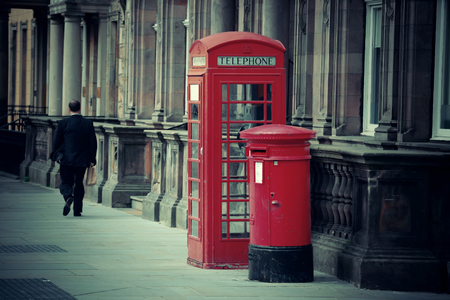 ancient telephone: Edinburgh city street view with telephone box in United Kingdom. Stock Photo