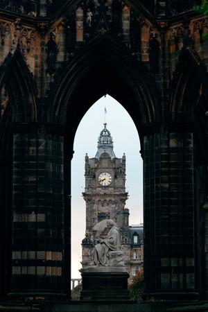 scott: Balmoral Hotel bell tower viewed through Scott Monument in Edinburgh Stock Photo