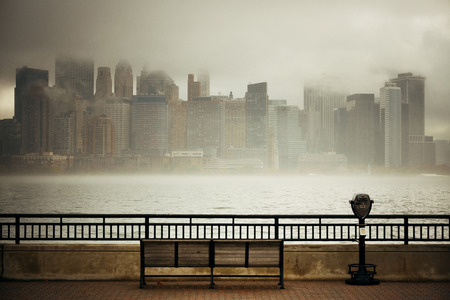 foggy: New York City downtown business district in a foggy day viewed from park