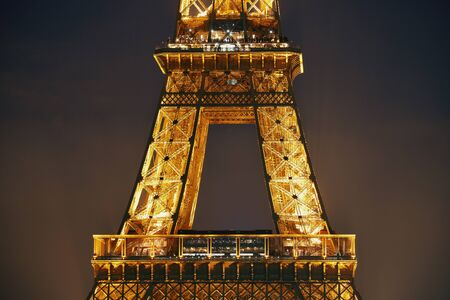 steel tower: PARIS, FRANCE - MAY 13: Eiffel Tower at night on May 13, 2015 in Paris. It is the most-visited paid monument in the world with annual 250M visitors.