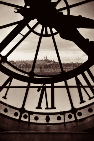 paris france: City view through Giant clock tower in Paris, France.