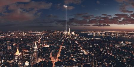 New York City downtown skyline panorama night view with September 11 tribute light..