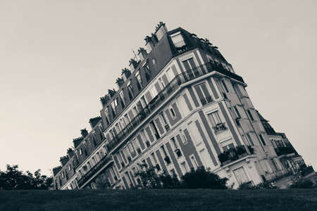 slope: French style building behind a slope. Paris Editorial