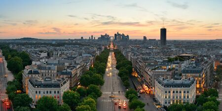 Paris sunset rooftop view of the city skyline with la Defense business district in France. Stock Photo