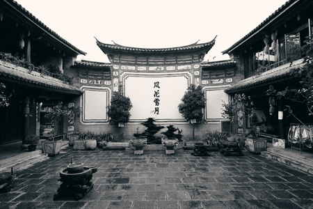 he is a traditional: Local Bai style courtyard in Dali old town. Yunnan, China.