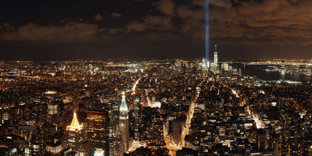 september 11: New York City downtown skyline panorama night view with September 11 tribute light..