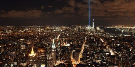 september 11: New York City downtown skyline panorama night view with September 11 tribute light..