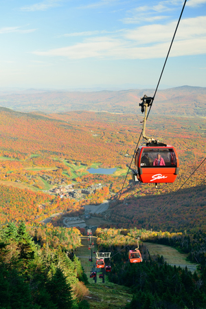 voted: STOWE, VERMONT - OCT 11: Gondola lift and Autumn foliage on October 11, 2015 in Vermont. Stowe is voted as Americas best town for Fall colors in 2015. Editorial