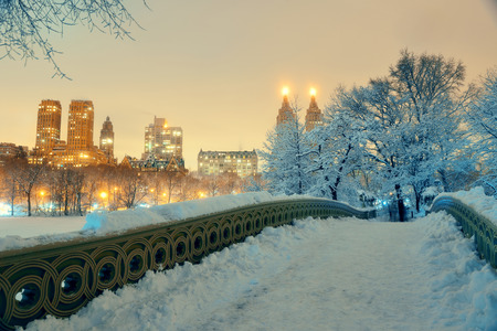 midtown manhattan: Central Park winter with skyscrapers and Bow Bridge in midtown Manhattan New York City