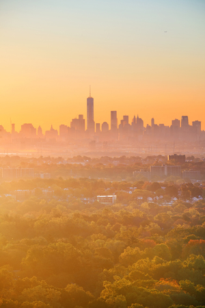foggy: New York City downtown sunrise silhouette viewed from park Stock Photo