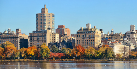 garden city: Central park Manhattan east side luxury building over lake in Autumn in New York City.