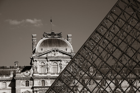 blackwhite: PARIS, FRANCE - MAY 13: Louvre museum closeup exterior view on May 13, 2015 in Paris. With over 60k sqM of exhibition space, Louvre is the biggest Museum in Paris.