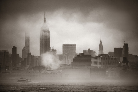 fog: Midtown Manhattan skyscrapers and boat in fog in New York City