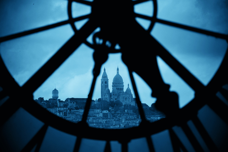 paris france: Sacre-Coeur viewed through Giant clock tower in Paris, France.
