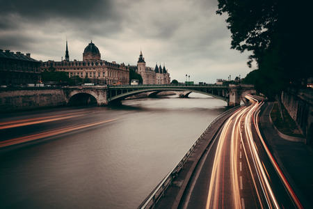traffic building: River Seine with bridge and traffic light trail Stock Photo